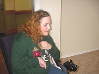 Carolyn in wheelchair entering new apartment